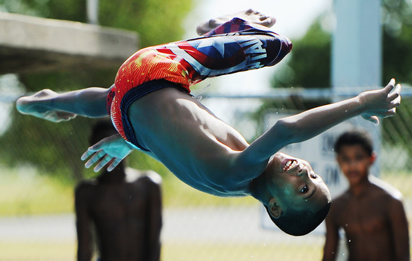 Globe/T. Rob Brown<br /> James Acres, 11, of Joplin, leaps feet-over-head off the diving board at Schifferdecker Park Pool Thursday afternoon, Aug. 2, 2012.