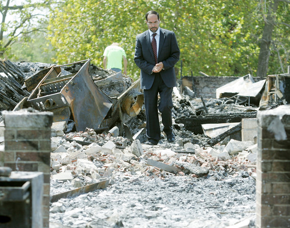 Globe/Roger Nomer<br /> Nihad Awad, executive director of the Council on American-Islamic Relations, walks through the remnants of the mosque of the Islamic Society of Joplin during a visit on Wednesday, Aug. 8, 2012.