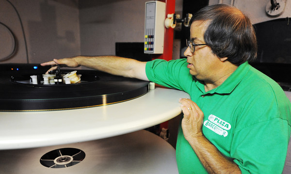 Globe/T. Rob Brown<br /> Scott Kelley, manager and projectionist at the Plaza, the downtown cinema in Lamar, loads a film onto the main film plate Thursday morning, Aug. 23, 2012. The cinema is in need of funds to upgrade from a film to a digital projector due to the inevitable discontinuance of movies released on film.