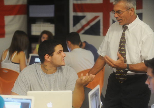 Globe/Roger Nomer<br /> Gus Ortega, senior, talks with Senior Communication Arts teacher Thomas MacQueeney during class on Thursday.