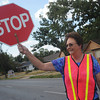 Globe/Roger Nomer<br /> Crossing guard Donna Goodson stops traffic along 15th Street for student crossing on Wednesday afternoon.  With area schools back in session, drivers are reminded to be aware of school busses and crossings.