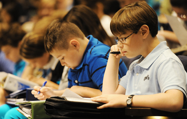 Globe/T. Rob Brown<br /> Thomas Jefferson Independent Day School sixth graders Grant VanDomelen, right, and Isaac Dickinson read over a student commitment form Tuesday afternoon, Aug. 21, 2012, before signing in agreement to follow the school's Honor Code. The key portions of the code involve the following: respect, compassion, honesty, truthfulness, self-discipline, perseverance, trust, consideration and sportsmanship.