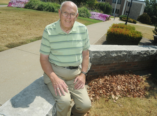 Globe/Roger Nomer<br /> Keith Adams sits on a bench made from capstones from Joplin Junior College.  When Adams attended the college in the late 40's, he would sit with friends between classes on the same capstones.