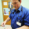 Globe/T. Rob Brown<br /> Physician assistant Joshua Newton examines patient Lisa Gray, of Girard, Kan., Friday afternoon, Aug. 3, 2012, at the Community Health Center of Southeast Kansas in Pittsburg.