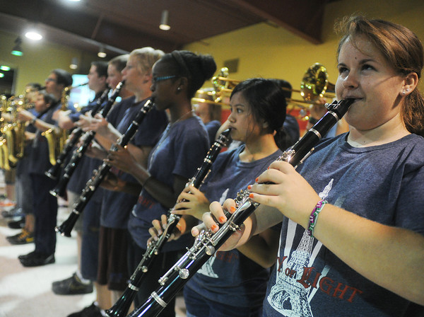 Globe/Roger Nomer<br /> Hannah Huffman, sophomore, right, plays with the band during Monday's rally at the Holiday Inn Convention Center.