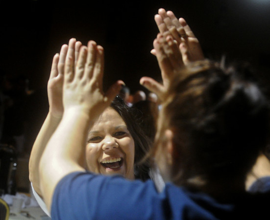 Globe/Roger Nomer<br /> Teresa Adams, principal at Duneweg/Duquesne Elementary, high fives a fellow educator during Monday's rally.