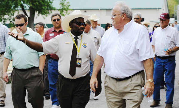 Globe/T. Rob Brown<br /> David Hendrix, left, Neosho National Fish Hatchery manager, takes Congressman Billy Long, right, and his entourage on a tour of the hatchery Friday afternoon, Aug. 24, 2012, during the Congressman's agriculture and industry tour in Southwest Missouri.