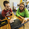 Globe/T. Rob Brown<br /> Jake Mitchell, left, of Joplin, works with speech language pathologist Rehna Logan, of Springfield, with a computer learning game that tests cognitive thinking skills, attention, memory and processing speed Wednesday afternoon, Aug. 1, 2012, at the Ozark Neuro Rehab Center in Springfield.