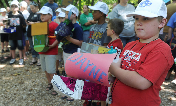Globe/Roger Nomer<br /> Dayne Butler, 8, Webb City, waits in line to race his cardboard boat during the Shoal Creek Water Festival on Saturday.