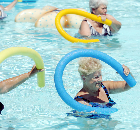 Globe/Roger Nomer<br /> Jane Flewelling does an arm exercise during a water fitness class at Walton Park pool in Nevada on Tuesday afternoon.