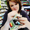 Globe/T. Rob Brown<br /> Hallmark artist Kristina Ganghran, of Kansas City, Mo., signs a Christmas tree ornament she helped create during a signing with other Hallmark artists Saturday afternoon, Aug. 4, 2012, at the Hallmark store on West Seventh Street in Joplin.