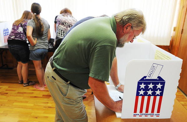 Globe/T. Rob Brown<br /> Paul Holland, of Saginaw, and several others vote at the Saginaw polling location Tuesday afternoon, Aug. 7, 2012. This polling location had about 400 voters by the afternoon.