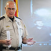 Globe/T. Rob Brown<br /> Jasper County Sheriff Archie Dunn speaks Monday afternoon, Aug. 6, 2012, at the Jasper County Sheriff's Department offices in Joplin/Atlas about the investigation of the Monday morning fire at the Islamic Center of Joplin. The projected image behind Dunn is from a video feed of an attempted arson suspect from the July 4 arson attempt.
