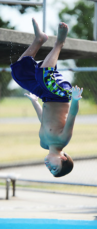 Globe/T. Rob Brown<br /> Isiaah Carl, 11, of Austin, Texas, flips upside down off the diving board at Schifferdecker Park Pool Thursday afternoon, Aug. 2, 2012. Carl was visiting his father, Jason Carl, of Joplin.