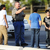 Globe/T. Rob Brown<br /> An investigator asks questions of mosque members outside the Islamic Society of Joplin mosque Monday morning, Aug. 6, 2012.