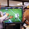 Globe/T. Rob Brown<br /> David Tyson, left, senior vice president and an owner of Lakeland Office Systems in Joplin, speaks and demonstrates the capabilities of the Sharp Aquos Board, a 70-inch 1080p touchscreen display for classrooms, with Connie Christen, a kindergarten teacher from Cassville R-IV School District, during a technology summit Friday morning Aug. 3, 2012, sponsored by the Southwest Center for Educational Excellence, at Missouri Southern State University's Billingsly Student Center.