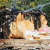 Globe/T. Rob Brown<br /> A Carl Junction firefighter works to extinguish the smoldering remains of the Islamic Society of Joplin mosque Monday morning, Aug. 6, 2012.