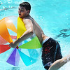 Globe/T. Rob Brown<br /> Kevin Cochran, 17, of Lafayette, Calif., tries to keep his balance on a large, inflatable ball at Schifferdecker Park Pool Thursday afternoon, Aug. 2, 2012. Cochran and fellow youth group tornado cleanup volunteers from the Oakland, Calif., included 52 students and 12 advisers who needed to cool off after working in the heat all day.