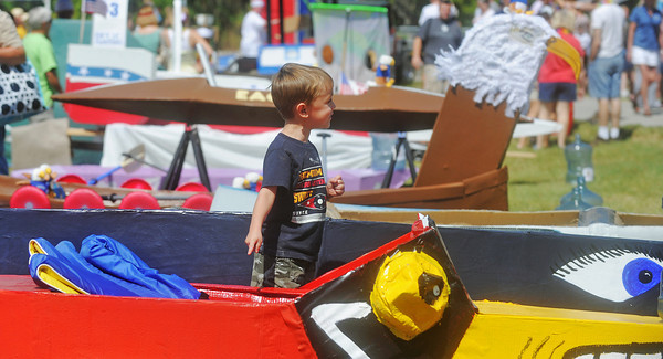 Globe/Roger Nomer<br /> Alex Brady, 4, points out one of his favorite cardboard boats while visiting the Shoal Creek Water Festival on Saturday.