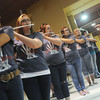 Globe/Roger Nomer<br /> The flute section of the Joplin High Marching Band plays the school's fight song for faculty and staff at Monday's rally.