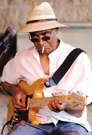 Globe/T. Rob Brown<br /> Guitarist Hummer Johnson, of Tulsa, Okla., performs rhythm and blues with the band Dues Paid Saturday, Aug. 4, 2012, at the main pavilion during the Emancipation Celebration at Ewert Park.