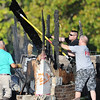 Globe/T. Rob Brown<br /> Carl Junction firefighters maneuver debris following a fire at the Islamic Society of Joplin mosque Monday morning, Aug. 6, 2012.