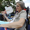 Globe/T. Rob Brown<br /> Barbara Sanders, of Neosho, tries to keep cool with a political fan Tuesday evening, July 31, 2012, during the Republican Women of Newton County watermelon feed in Neosho's Big Spring Park.