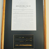 Globe/Roger Nomer<br /> A framed senate bill and pens from the legislation establishing Missouri Southern State University.