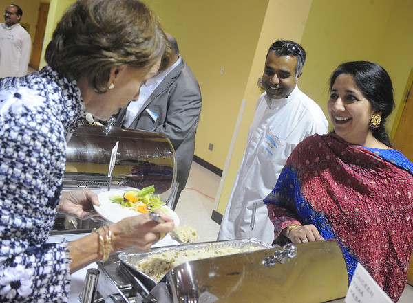 Globe/Roger Nomer<br /> Suzanne Duncan talks with Ayesha Ahmed about the special dishes prepared for Eid al-Fitr at the Holiday Inn Convention Center on Sunday afternoon.