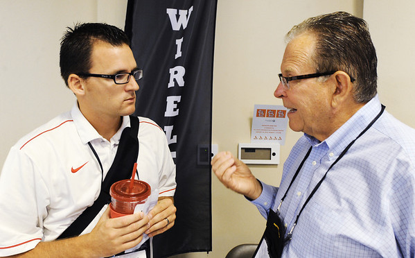 Globe/T. Rob Brown<br /> Brad Moser, left, Webb City R-VII School District physics teacher and technology committee member, speaks to vender Bill Ryan, senior consultant with Provision Data Solutions during a technology summit Friday morning Aug. 3, 2012, sponsored by the Southwest Center for Educational Excellence, at Missouri Southern State University's Billingsly Student Center.