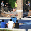 Globe/T. Rob Brown<br /> An investigator asks questions of witnesses, who regularly worship at the mosque, as Carl Junction firefighters work in the background at the Islamic Society of Joplin mosque Monday morning, Aug. 6, 2012.