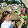 Globe/Roger Nomer<br /> Bobi Lawrence, DeSoto, Kan., hammers a beam at North Joplin Headstart as the playground build begins on Saturday morning.