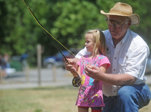Globe/Roger Nomer<br /> Emily Bender gets a lesson in fly fishing from George Hammond, with MACO Fly Fishers, at the Shoal Creek Water Festival on Saturday.