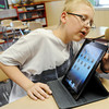 Globe/Roger Nomer<br /> Dolph Holtwick, a seventh grader at Baxter Springs Middle School, explores his new iPad on Monday afternoon.