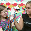 Globe/Roger Nomer<br /> Jennalee Dunn, 8, and Daisy Hegland make a pinwheel at the Art Feeds van during Friday's block party hosted by the Community Partnership and Life House at Fifth and North Wall Streets.