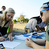 Globe/T. Rob Brown<br /> Crystal Hope, of Joplin, left, signs up for an American Idol audition with Hailey Manion, right, production assistant, at Landreth Park Wednesday morning, Aug. 22, 2012.