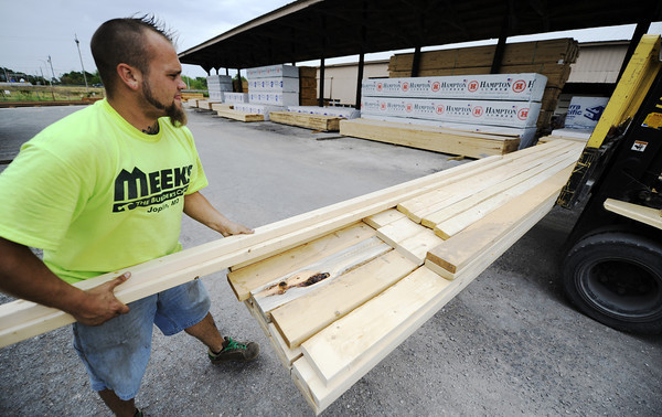 Globe/T. Rob Brown<br /> Forrest Stockton, delivery driver at Meek's, loads up some lumber for a customer recently at the Range Line Road store's warehouse.