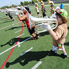 Globe/T. Rob Brown<br /> Sophomore Samuel Hathcock, right, plays the baritone as he and the rest of the marching band cast their shadows during the Webb City High School Band Camp Thursday morning, Aug. 2, 2012, at the school's field.