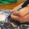 Globe/Roger Nomer<br /> Jerry Caskey works on a drawing at the Joplin Public Library on Tuesday morning.