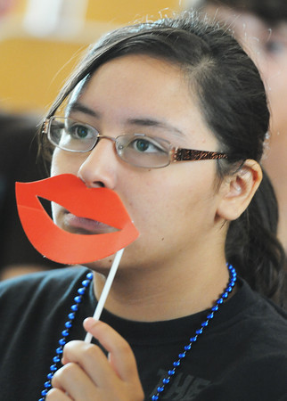 "Globe/T. Rob Brown<br /> Incoming Joplin High School freshman Alejandra Piña gets a classmate's attention with ""lips on a stick"" as they wait for a seminar to start Thursday afternoon, Aug. 8, 2013, at the freshman and sophomore campus."