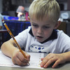 Globe/Roger Nomer<br /> Thomas Jefferson kindergartner Eric Pankey concentrates on writing his name on the first day of class at the school on Monday morning.