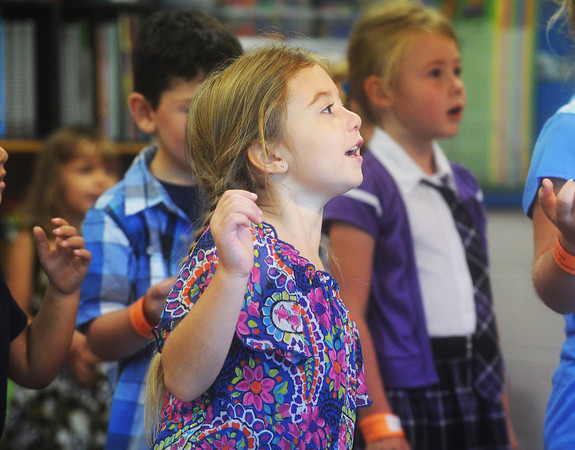 Globe/Roger Nomer<br /> Kindergartner Emily McGuirk sings along during the first day of class at Cecil Floyd Elementary.