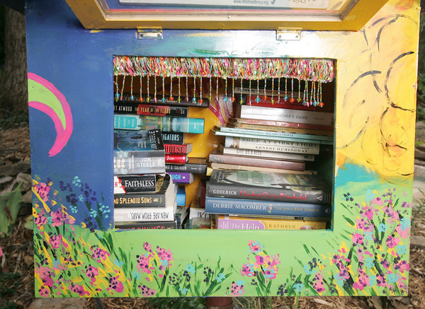 Globe/Roger Nomer<br /> The inside of Daria Claiborne's Little Free Library is stacked with books.