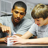 Globe/T. Rob Brown<br /> Lab partners, sophomores Damian Campbell (left) and Carter Smith, attempt to solve a puzzle cube in LaHeather Fisher's science class Thursday morning, Aug. 22, 2013, at the Joplin High School freshman and sophomore campus at Memorial.