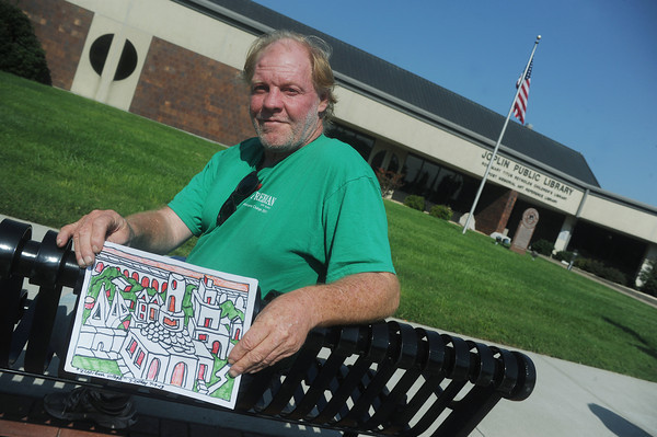 Globe/Roger Nomer<br /> Jerry Caskey shows one of his works in front of the Joplin Public Library.