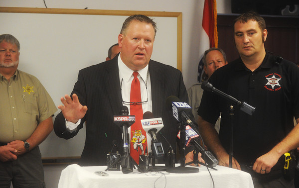 Globe/Roger Nomer<br /> Barton County Prosecutor Steven Kaderly and Barton County Sheriff Mitchell Shaw address the media during a press conference in Lamar on Friday.