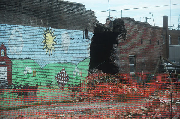 Globe/Roger Nomer<br /> Demolition of a building in the 900 block of Main Street left a hole in the building to the immediate south of the building being demolished.