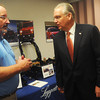 Globe/Roger Nomer<br /> Ross Turner, general manager at the Leggett and Platt Flex-O-Lator facility talks with Gov. Jay Nixon on Wednesday morning.