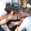 Globe/T. Rob Brown<br /> Search and rescue team members embrace and shake hands (foreground) back at the search headquarters in downtown Golden City Wednesday afternoon, Aug. 21, 2013, after the girl's body was discovered in a field.