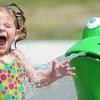 Globe/T. Rob Brown<br /> Two-year-old Brenley Comer of Joplin reacts excitedly to being splashed by a waterpark frog Thursday afternoon, Aug. 22, 2013, at Parr Hill Park.